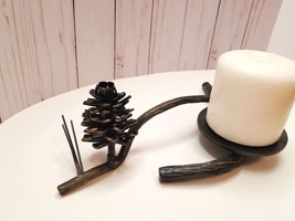 Fir cone style candle holder